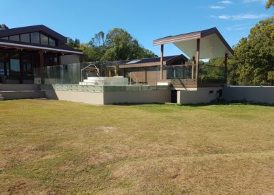 """Frameless Glass Pool Fencing With A """"Button"""" System In Talofa"""